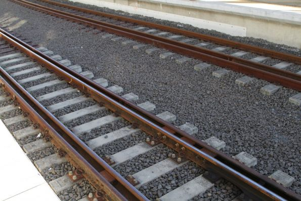 Two types of dual gauge track at Roma Street station