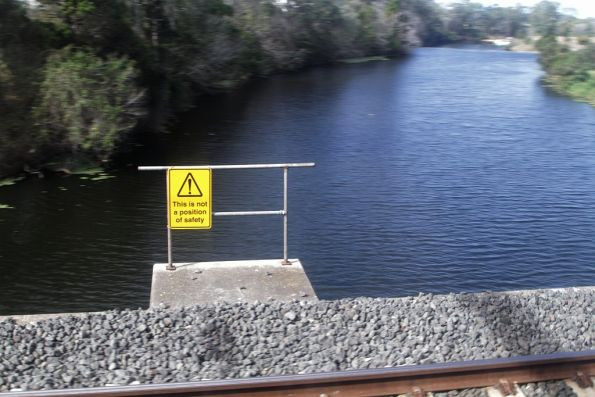 'This is not a position of safety' notice on the bridge across the Caboolture River