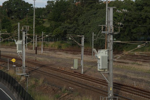 Traction power transformers mounted to stanchions on the Exhibition Loop at Normanby