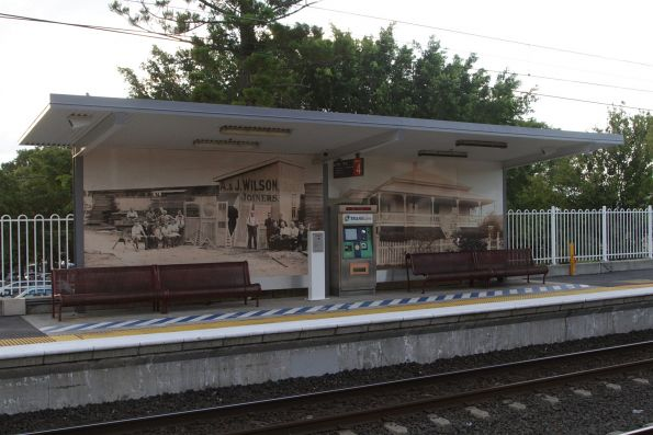 Platform shelter, seats, ticket machine and emergency phone at Wooloowin station