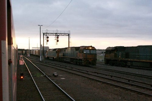 NR93 and AN8 arrive at Tottenham Junction on the up with AB6 at 1858