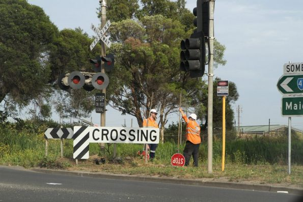 Traffic controllers in place due to damaged level crossing lights on the Apex quarry siding at Somerville and McDonald Road in Brooklyn