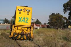 X42 negotiates the overgrown track on the curve