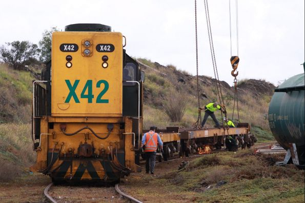 The last two wagons position by X42, chocks in places as the gas axe cuts away at the brake rigging