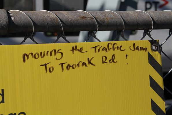 Some wag has scrawled 'Moving the traffic jam to Toorak Road!' on the government propaganda signage