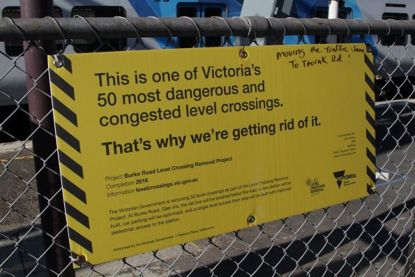 Government signage promoting the Burke Road Level Crossing Removal Project