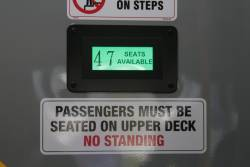 'X seats available' sign beside the upper deck staircase of CDC Melbourne double decker bus #131