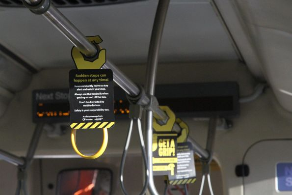 'Sudden stops can happen at any time' promotional signs onboard a Transdev bus