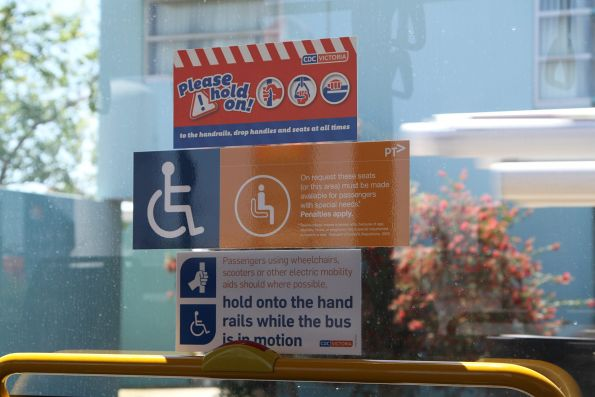 CDC Victoria branded 'Please hold on' stickers onboard a bus