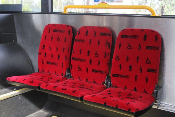 'CDC Priority' seat fabric in red onboard a CDC Melbourne bus