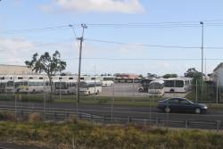 Mitsubishi Rosa, Toyota Coaster and Optare Solo minibuses at the Sita depot in West Footscray