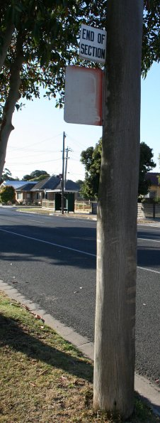 Old bus 'End of Section' sign in Geelong