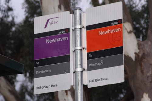 Bus signage at Newhaven, Phillip Island - purple for the V/Line coach to Dandenong, and orange for the local bus to Wonthaggi