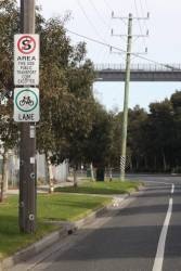 'No standing this side Public Transport Corp Excepted' sign on Lorimer Street, Fishermans Bend