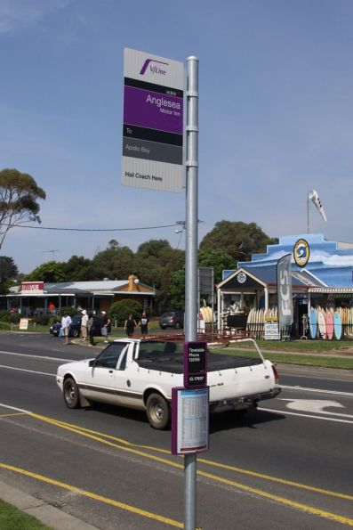 V/Line bus stop in Anglesea, with a stop ID plate on the post