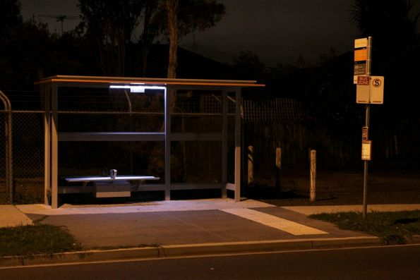Bus stop shelter with solar powered LED lighting