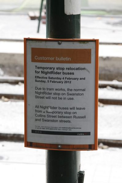 Sign informing passengers Nightrider bus stops have moved from Swanston to Collins Street due to tram works: too bad they'll hiding behind a construction hoarding...