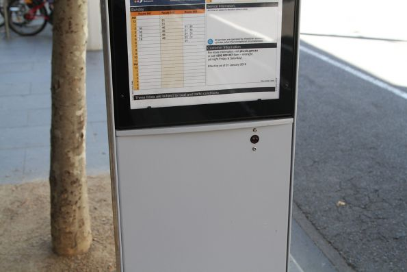 Electronic looking sensor in the side of a solar powered bus stop totem
