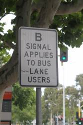 'B signal applies to bus lane users' sign on Hoddle Street