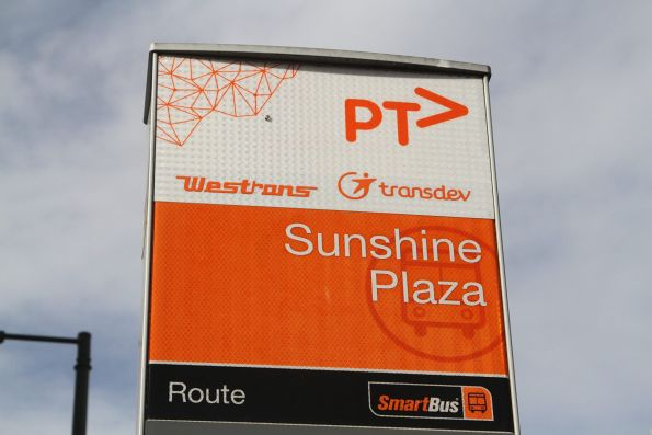 Westrans and Transdev logos on the bus stop at Sunshine Plaza