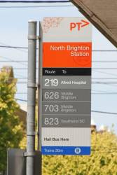 Bus stop at North Brighton station modified to read 'Route 219 Alfred Hospital'