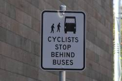 'Cyclists stop behind buses' sign at a bus stop on Southbank Boulevard