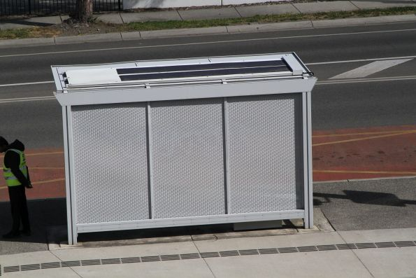 Solar panels on the top of a bus shelter
