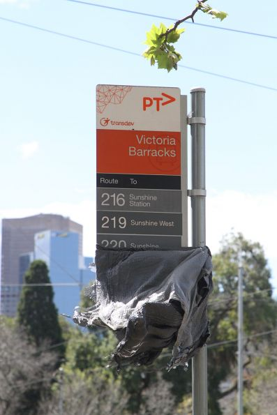 Uncovered route 216, 219 and 220 bus stop sign at Victoria Barracks on St Kilda Road