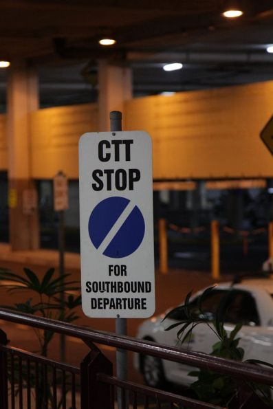 'CTT Stop for southbound departure' sign at Cairns station
