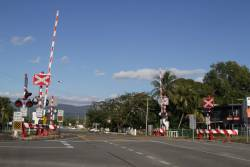 Candy striped level crossing in the suburbs of Cairns