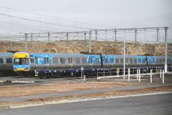 Alstom Comeng 509M stabled alongside an empty rake of CQCY container flats at Calder Park