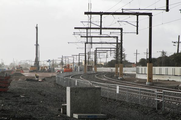 Mainline track slewed so the station and yard can be demolished, piling rig at work on the future elevated track