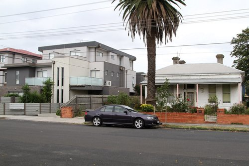 Houses along the railway line at Carnegie, already overlooked by three story high apartment buildings