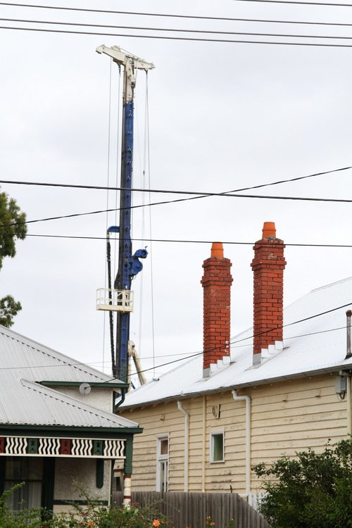 Piling rig visible over houses at Carnegie