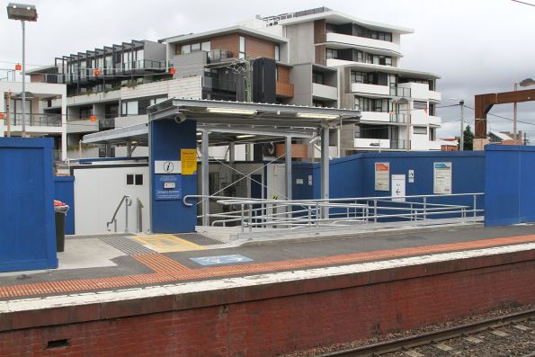 Six story apartment block overlooks Carnegie station platform 1