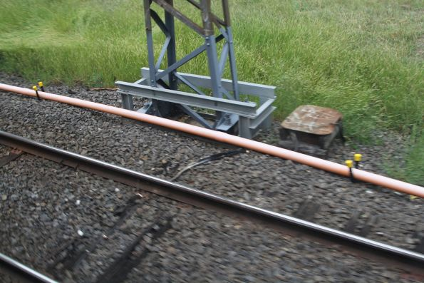 Temporary conduit carries signalling cables at Yarraman station