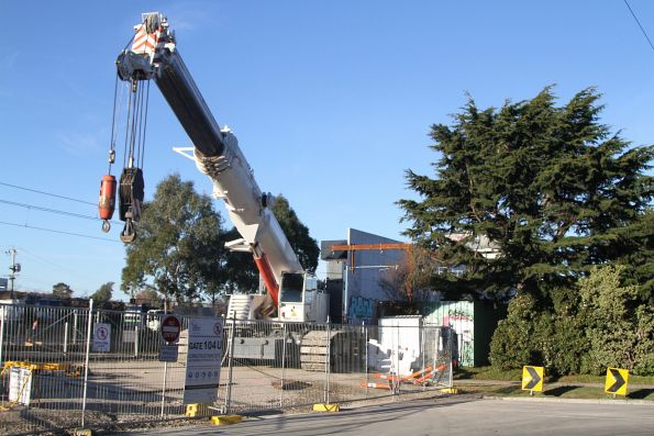 Crane parked beside Cosy Gum Road in Carnegie