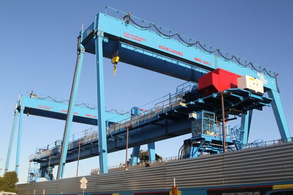 Two gantry cranes and the straddle carrier ready to go at Murrumbeena station