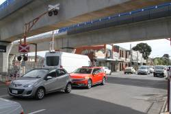 Skyrail spans across the Murrumbeena Road level crossing at Murrumbeena
