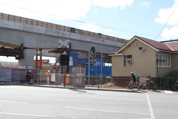 New bridge spans tower over the existing station building at Clayton