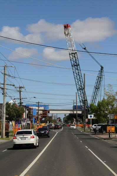 Crane between jobs installing bridge spans at Centre Road, Clayton
