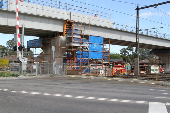 Single twin track viaduct beside the level crossing at Chandler Road, Noble Park