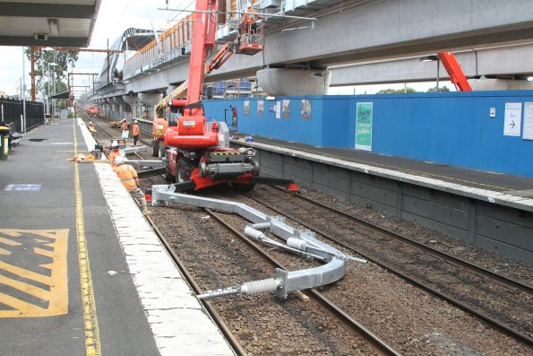 Installing new overhead stanchions for the elevated tracks at Noble Park