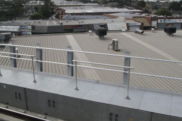 Looking out over industrial buildings from the new elevated tracks at Clayton