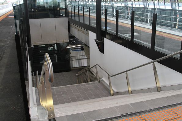 Stairs up to platform level at the new elevated Clayton station