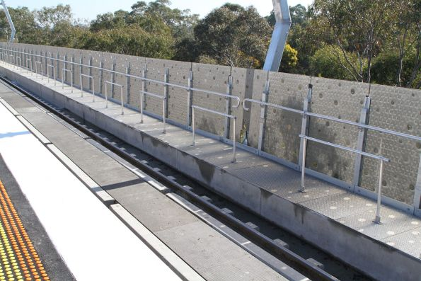 Maintenance walkway alongside the tracks at Hughesdale station