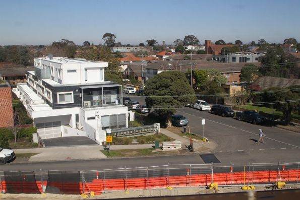Apartment blocks and train passengers look down on houses between Hughesdale and Murrumbeena stations