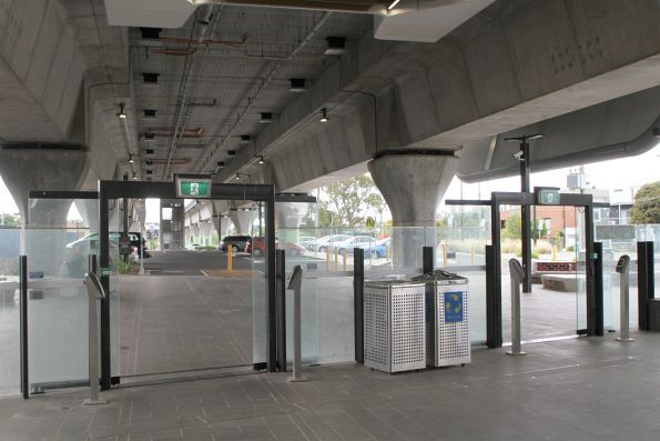 Emergency exit at the east end of Murrumbeena station fitted with Myki readers and open for everyday use