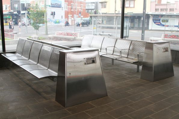 Steel bench seats in the waiting room at Murrumbeena station