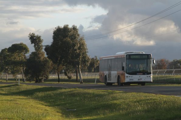 CDC Melbourne bus #110 7361AO on a route 449 service passes Werribee Racecourse